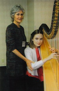 Alexander Technique teacher Phyllis Richmond works with a harpist