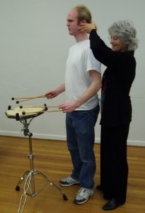 Alexander Technique teacher Phyllis Richmond works with a drummer